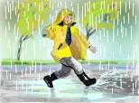copil jucandu se  in ploaie